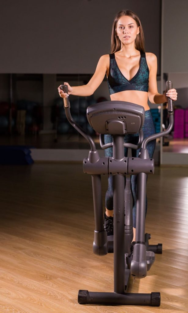 young girl using elliptical
