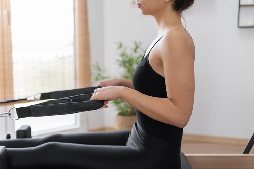 Chest Expansion exercising on pilates reformer bed