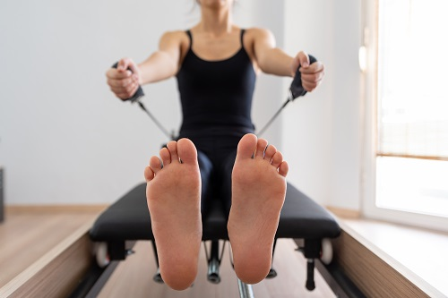 pilates reformer exercises for beginners arm stretch